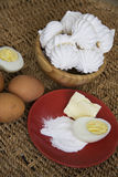 Raw eggs and baked meringues Stock Images