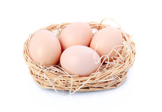 Raw eggs in basket isolated on white Royalty Free Stock Photography
