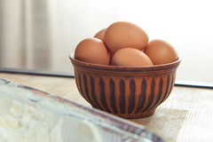 Raw eggs in bowl. Close-up view of raw eggs in bowl on kitchen table Stock Photography
