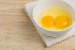 Raw eggs in a bowl, hammering. The main raw materials Cooking eggs Stock Photography