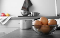 Raw eggs in bowl. On kitchen table Stock Image