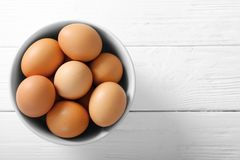 Raw eggs in bowl. On kitchen table Royalty Free Stock Image