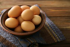 Raw eggs in bowl. On kitchen table Stock Images