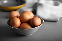 Raw eggs in bowl on   table. Raw eggs in bowl on kitchen table Royalty Free Stock Image