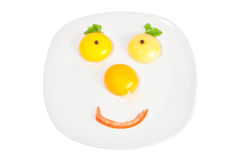 Raw eggs in a bowl in the shape of the face. Royalty Free Stock Photography