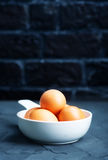 Raw eggs. In bowl and on a table Stock Images