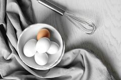 Raw eggs in bowl on   table. Raw eggs in bowl on kitchen table Royalty Free Stock Photo