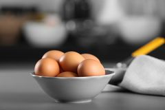 Raw eggs in bowl on table. Raw eggs in bowl on kitchen table Royalty Free Stock Photos