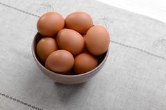 Raw eggs in bowl. On tablecloth Royalty Free Stock Photo