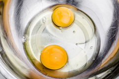 Raw eggs. Eggs in a bowl for whipping Stock Images