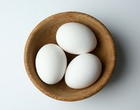 Raw eggs in bowl. On white background Stock Photography