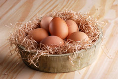 Raw eggs in the bowl. Raw eggs in wooden bowl Royalty Free Stock Photos