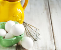 Raw eggs. In bowl on wooden background Stock Images