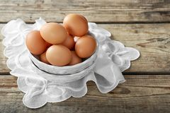 Raw eggs in bowl. On wooden background Royalty Free Stock Photos