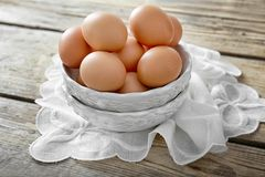 Raw eggs in bowl. On wooden background Royalty Free Stock Images