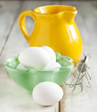 Raw eggs. In bowl on wooden table Royalty Free Stock Images