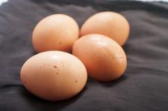 Raw eggs close up on black background Stock Photo