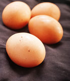 Raw eggs close up on black background Stock Image