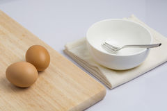 Raw eggs and cooking equipment Royalty Free Stock Photo