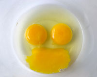 Raw eggs forming a smiley/happy face Royalty Free Stock Photography