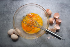 Raw eggs in glass bowl. On kitchen table. Preparation of omelet Stock Photography