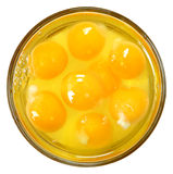 Raw Eggs in Glass Bowl Over White Stock Photography