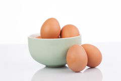 Raw eggs isolated in clay bowl Stock Photography