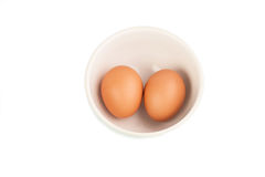 Raw eggs isolated in clay bowl Royalty Free Stock Photo