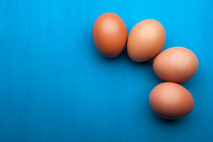 Raw eggs on the kitchen table. Raw eggs are blue semicircle on the kitchen table Royalty Free Stock Photos