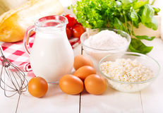 Raw eggs, milk, cottage cheese and flour Royalty Free Stock Photography
