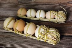 Raw eggs packed in straw Royalty Free Stock Photos
