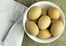 Raw eggs on the plate. On a towel Stock Photography