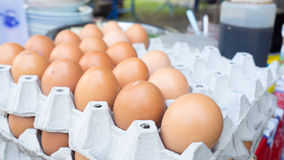 Raw eggs on the tray. Raw eggs on the tray ready to sell in Thailand Stock Photo