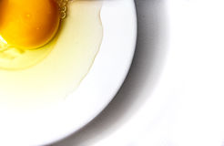 Raw eggs on white plate Stock Photo