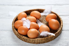 Raw eggs in a wicker tray Stock Images
