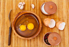 Raw Eggs on Wood Plate Stock Photography