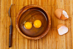 Raw Eggs on Wood Plate Royalty Free Stock Photo