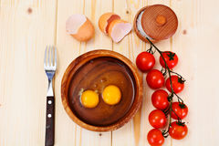 Raw Eggs on Wood Plate Stock Images