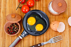 Raw Eggs on Wood Plate Royalty Free Stock Images