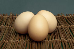 Raw eggs on wooden base Stock Photo