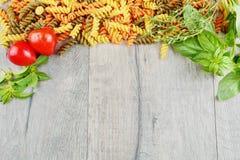 Raw eliche tricolori pasta background royalty free stock photo