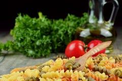 Raw eliche tricolori pasta background Stock Photos