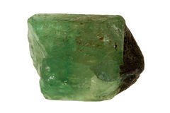 Raw emerald. Green stone from nature against white background Royalty Free Stock Images