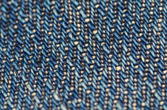 Raw faded Japanese denim macro view. Macro view of faded, indigo-dyed Japanese 15 ounce denim fabric stock images
