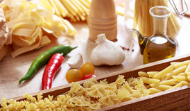 Raw farfalle pasta in a box. Raw farfalle pasta in a wooden box Royalty Free Stock Photos