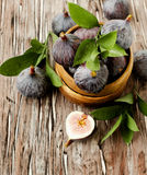 Raw figs in a wooden bowl, selective focus Stock Photos