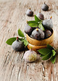 Raw figs in a wooden bowl, selective focus Stock Photo