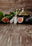Raw figs in a wooden bowl, selective focus Stock Image