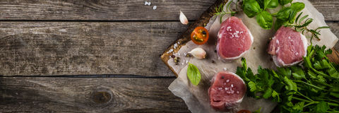 Raw filet mignon meat cuts with spice and herbs Royalty Free Stock Photo