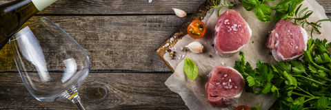 Raw filet mignon meat cuts with spice and herbs Royalty Free Stock Photos